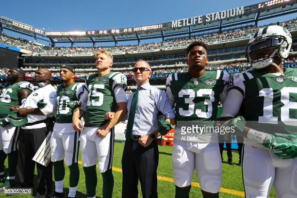 Jermaine Kearse and Josh McCown, Jamal Adams and Christopher Johnson CEO of the New York Jets stand in unison with their team during the National...