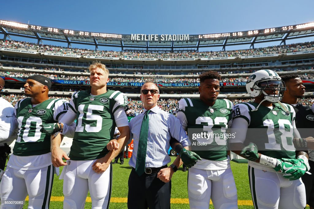 Jermaine Kearse #10, Josh McCown #15, Jamal Adams #33, ArDarius Stewart #18 and Christopher Johnson CEO of the New York Jets stand in unison with his team during the National Anthem prior to an NFL game against the Miami Dolphins at MetLife Stadium on September 24, 2017 in East Rutherford, New Jersey.