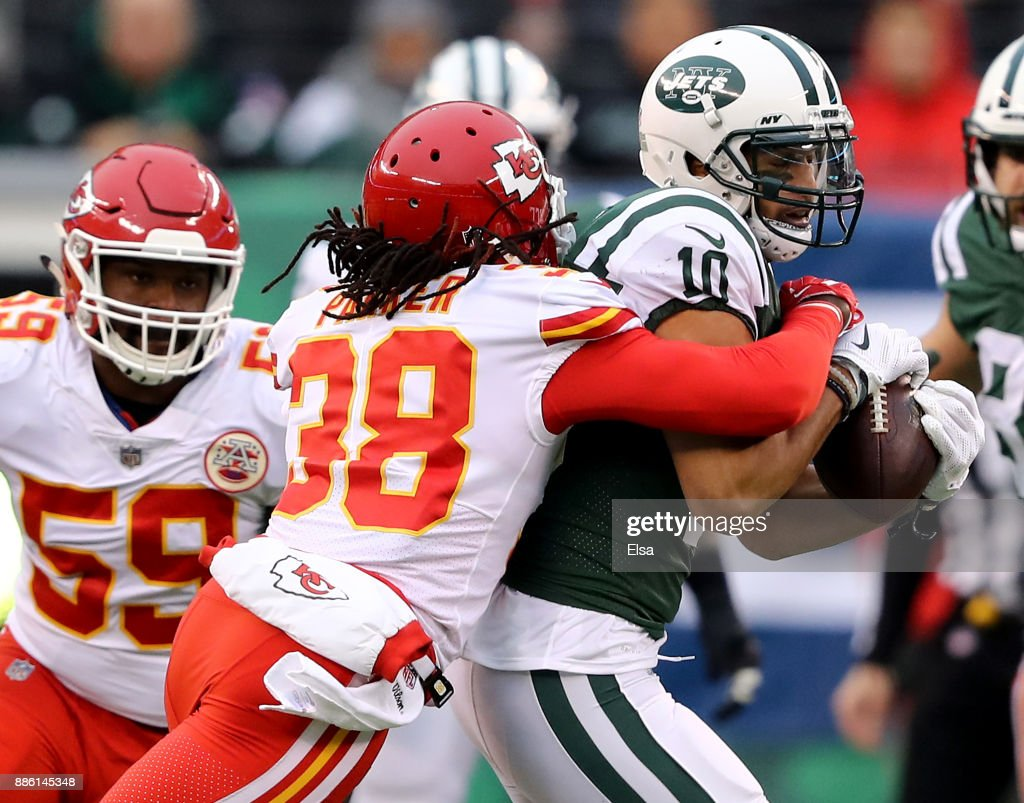 Jermaine Kearse #10 of the New York Jets carries the ball for the first down as Ron Parker #38 of the Kansas City Chiefs makes the tackle in the first quarter on December 03, 2017 at MetLife Stadium in East Rutherford, New Jersey.