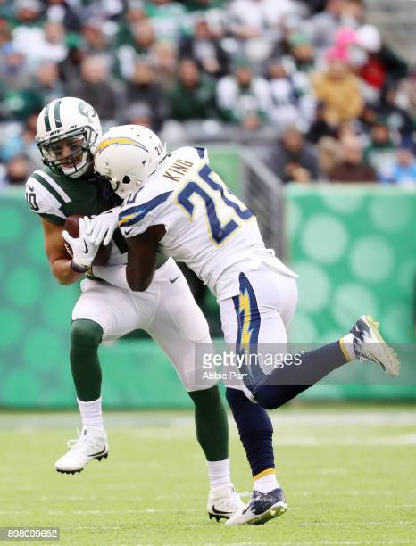 Jermaine Kearse of the New York Jets is tackled by Desmond King of the Los Angeles Chargers during the first half of an NFL game at MetLife Stadium...