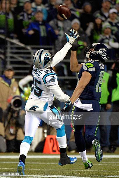 Jermaine Kearse of the Seattle Seahawks catches a pass over Bene' Benwikere of the Carolina Panthers to score a 63 yard touchdown in the second...