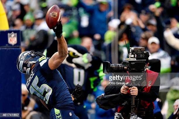 Jermaine Kearse of the Seattle Seahawks celebrates after he catches a 35yard gamewinning touchdown in overtime against the Green Bay Packers during...