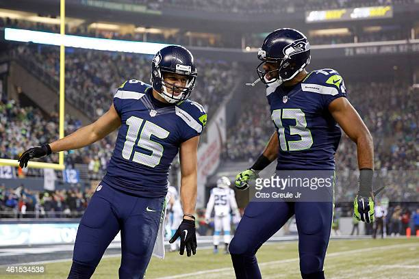 Jermaine Kearse of the Seattle Seahawks celebrates with Chris Matthews after scoring a 63 yard touchdown in the second quarter against the Carolina...