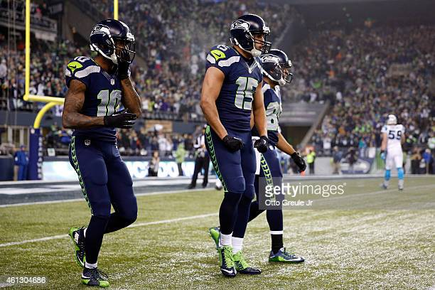 Jermaine Kearse of the Seattle Seahawks celebrates with his teammates after scoring a 63 yard touchdown in the second quarter against the Carolina...