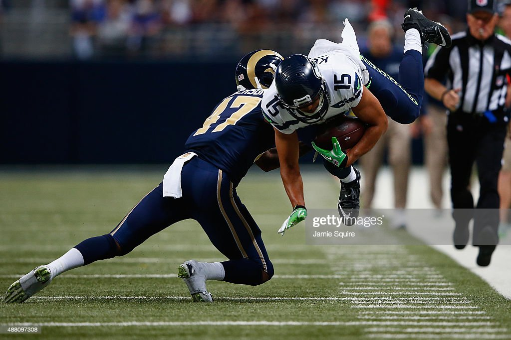 Jermaine Kearse #15 of the Seattle Seahawks is tackled in the fourth quarter against the St. Louis Rams at the Edward Jones Dome on September 13, 2015 in St. Louis, Missouri.