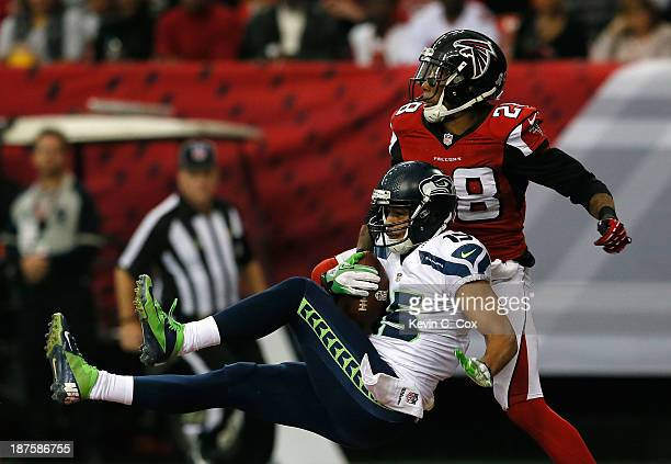 Jermaine Kearse of the Seattle Seahawks pulls in this touchdown reception against Thomas DeCoud of the Atlanta Falcons at Georgia Dome on November 10...