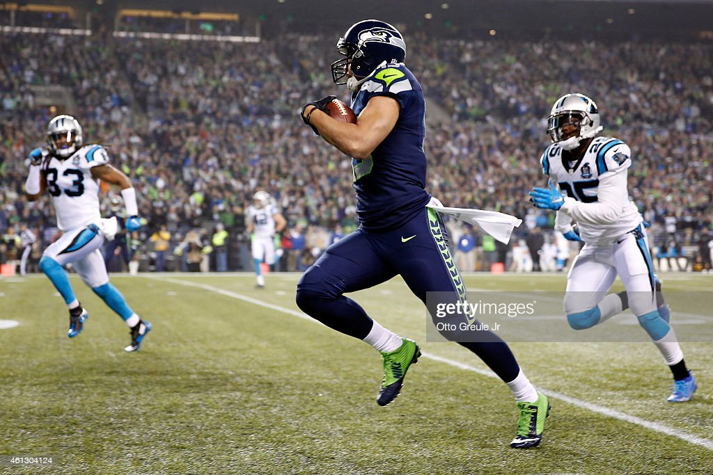 Jermaine Kearse #15 of the Seattle Seahawks scores a 63 yard touchdown in the second quarter against the Carolina Panthers during the 2015 NFC Divisional Playoff game at CenturyLink Field on January 10, 2015 in Seattle, Washington.