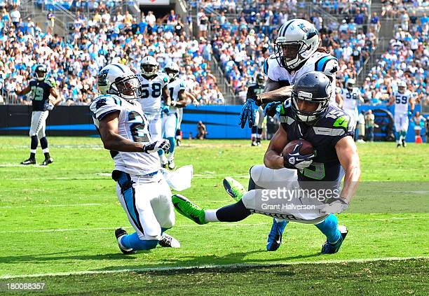 Jermaine Kearse of the Seattle Seahawks scores the gamewinning touchdown as Josh Norman and Charles Godfrey defend during pthe fourth quarter at Bank...