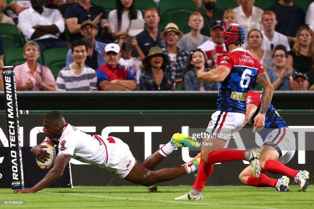 Jermaine McGillvary of England crosses for a try during the 2017 Rugby League World Cup match between England and France at nib Stadium on November 12, 2017 in Perth, Australia.