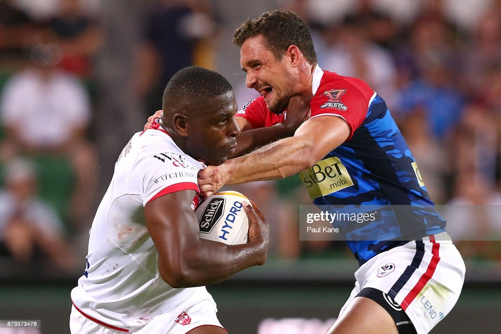 Jermaine McGillvary of England fends off a tackle by Bastien Ader of France during the 2017 Rugby League World Cup match between England and France at nib Stadium on November 12, 2017 in Perth, Australia.