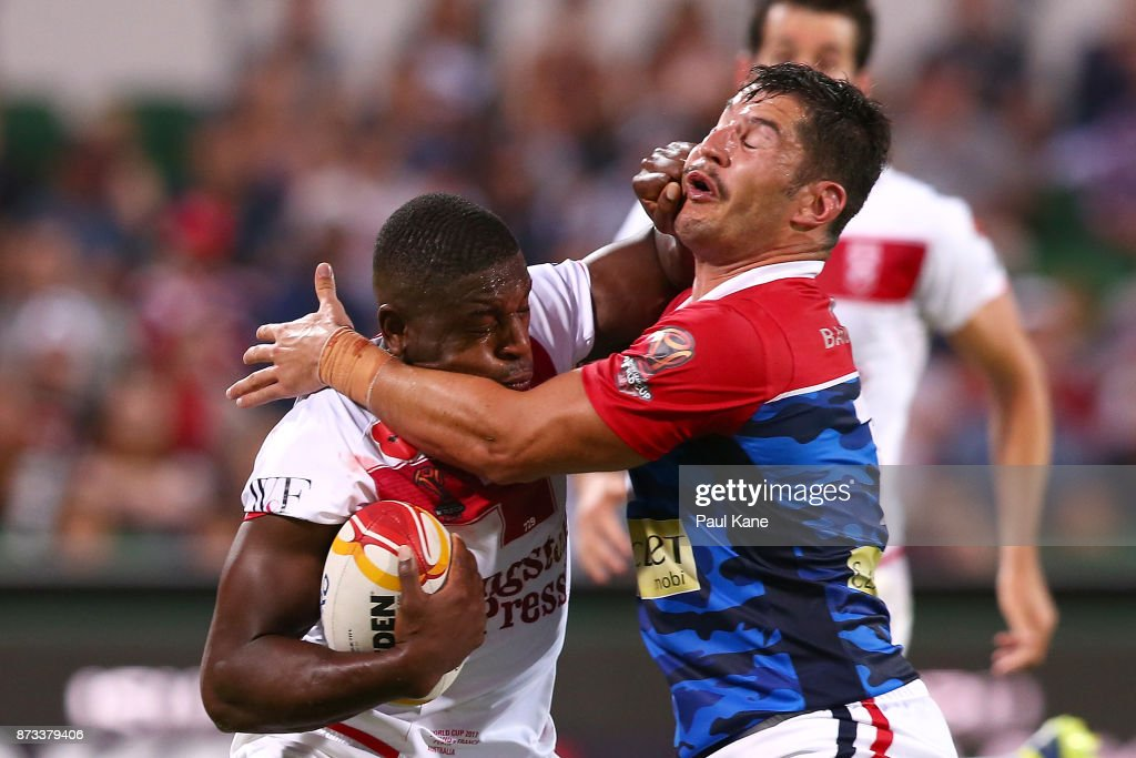 Jermaine McGillvary of England gets tackled by Benjamin Garcia of France during the 2017 Rugby League World Cup match between England and France at nib Stadium on November 12, 2017 in Perth, Australia.