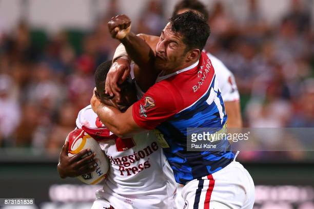 Jermaine McGillvary of England gets tackled by Remy Marginet of France during the 2017 Rugby League World Cup match between England and France at nib...