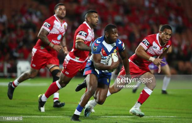 Jermaine McGillvary of Great Britain makes a break during the International Rugby League Test match between the Great Britain Lions and Mate Ma'a...
