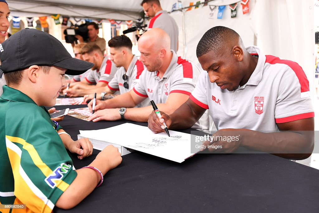 Jermaine McGillvary signs autographs for a young fan during an Australia Kangaroos and England Signing Session at Reddacliff Place on November 28, 2017 in Brisbane, Australia.