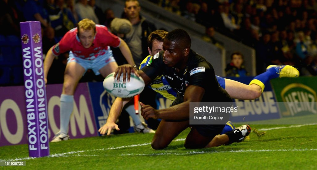 Jermaine McGilvary of Huddersfield scores a second half try durng the Super League Qualifying Semi Final between Warrington Wolves and Huddersfield Giants at The Halliwell Jones Stadium on September 26, 2013 in Warrington, England.