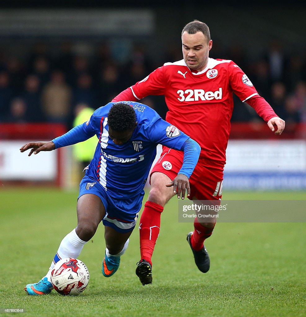 Jermaine McGlashan of Gllingham is fouled by Lee Fowler of Crawley during the Sky Bet League One match between Crawley Town and Gillingham at The Checkatrade.com Stadium on March 28, 2015 in Crawley, England.