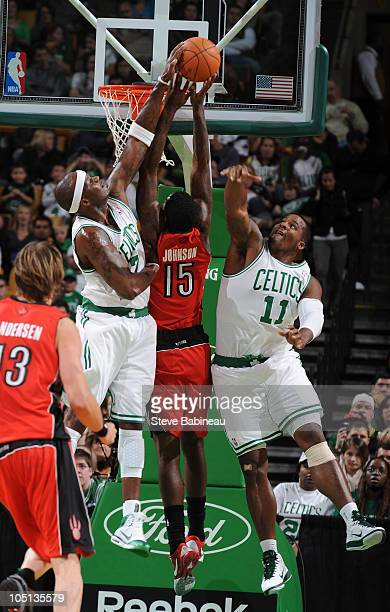 Jermaine O'Neal of the Boston Celtics blocks the shot against Amir Johnson of the Toronto Raptors on October 10 2010 at the TD Garden in Boston...