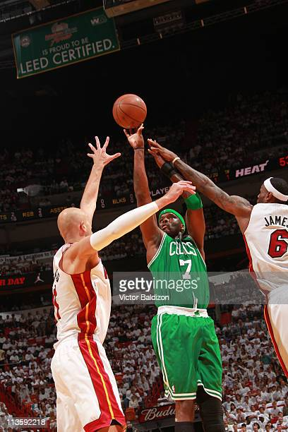 Jermaine O'Neal of the Boston Celtics shoots against LeBron James and Zydrunas Ilgauskas of the Miami Heat in Game Two of the Eastern Conference...