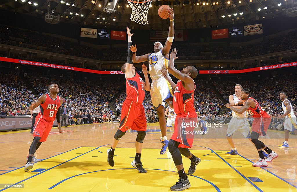 Jermaine O'Neal #7 of the Golden State Warriors drives to the basket against the Atlanta Hawks on March 7, 2014 at Oracle Arena in Oakland, California.