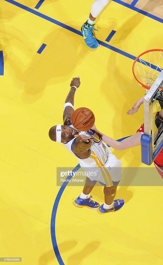 Jermaine O'Neal #7 of the Golden State Warriors reaches for the rebound against the Atlanta Hawks on March 7, 2014 at Oracle Arena in Oakland, California.