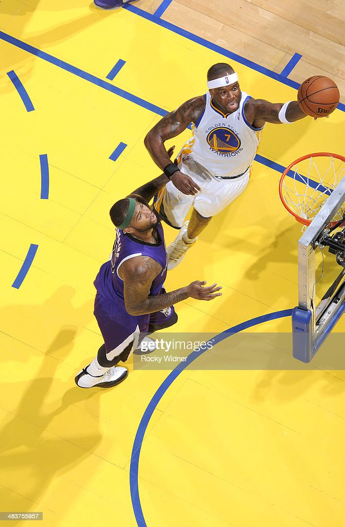Jermaine O'Neal #7 of the Golden State Warriors shoots a layup against DeMarcus Cousins #15 of the Sacramento Kings on April 4, 2014 at Oracle Arena in Oakland, California.