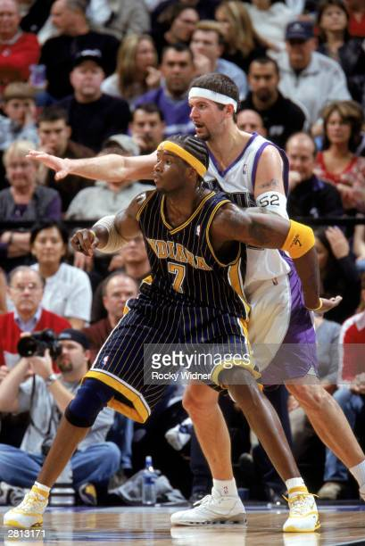 Jermaine O'Neal of the Indiana Pacers and Brad Miller of the Sacramento Kings battle for position during the NBA game at Arco Arena on December 7...