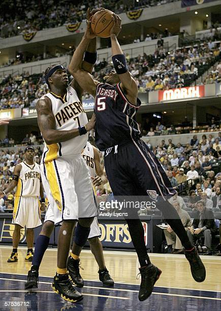 Jermaine O'Neal of the Indiana Pacers blocks a shot attempt by Vince Carter of the New Jersey Nets in game six of the Eastern Conference...