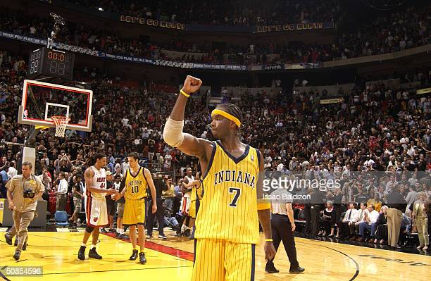 Jermaine O'Neal of the Indiana Pacers celebrates a victory over the Miami Heat in Game six of the Eastern Conference Semifinals during the 2004 NBA...