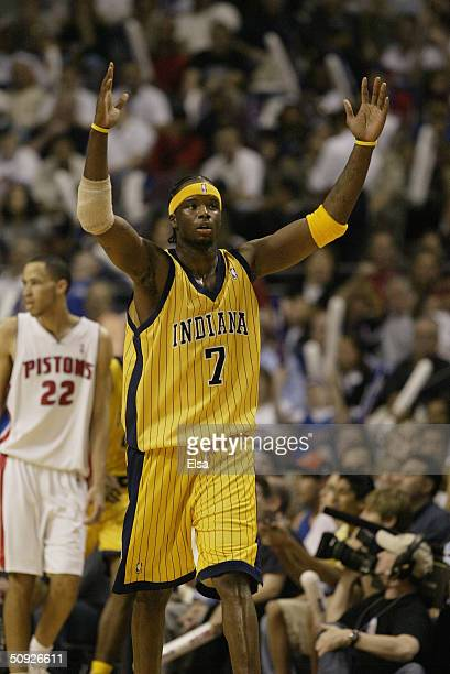 Jermaine O'Neal of the Indiana Pacers celebrates in Game four of the Eastern Conference Finals during the 2004 NBA Playoffs against the Detroit...