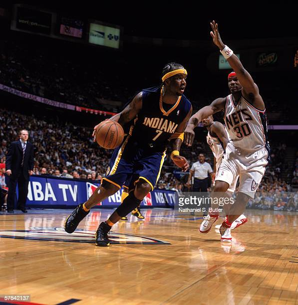 Jermaine O'Neal of the Indiana Pacers drives against Clifford Robinson of the New Jersey Nets in game five of the Eastern Conference Quarterfinals...
