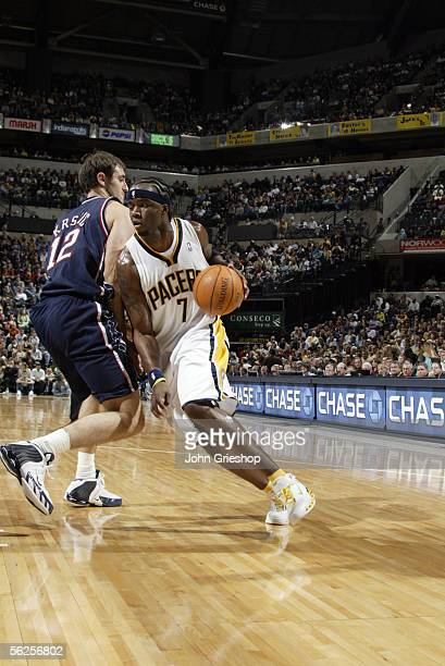 Jermaine O'Neal of the Indiana Pacers drives against Nenad Krstic of the New Jersey November 11, 2005 at Conseco Fieldhouse in Indianapolis, Indiana....
