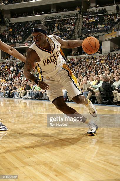 Jermaine O'Neal of the Indiana Pacers drives against the New Jersey Nets at Conseco Fieldhouse on November 17, 2006 in Indianapolis, Indiana. The...