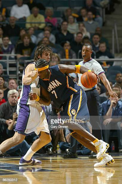 Jermaine O'Neal of the Indiana Pacers drives the ball past Andrew Bogut of the Milwaukee Bucks during the game at Bradley Center on November 12 2005...