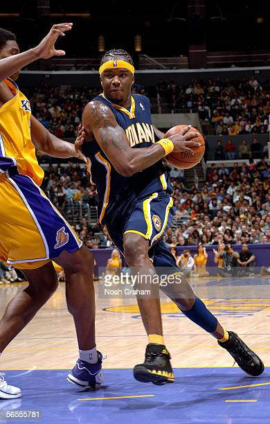 Jermaine O'Neal of the Indiana Pacers drives to the hoop against the Los Angeles Lakers on January 9 2006 at Staples Center in Los Angeles California...