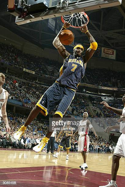Jermaine O'Neal of the Indiana Pacers dunks against the Cleveland Cavaliers on March 14 2004 at Gund Arena in Cleveland Ohio NOTE TO USER User...