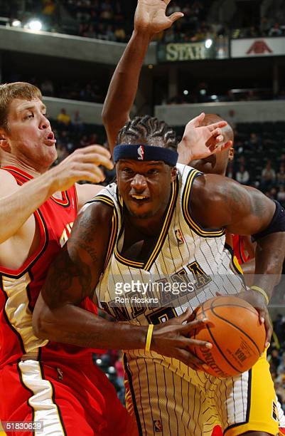 Jermaine O'Neal of the Indiana Pacers gets position against Jason Collier of the Atlanta Hawks November 17 2004 at Conseco Fieldhouse in Indianapolis...