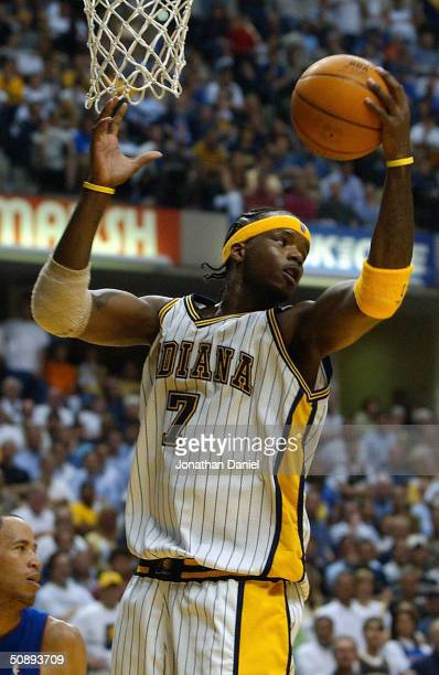 Jermaine O'Neal of the Indiana Pacers grabs a rebound in Game two of the Eastern Conference Finals against the Detroit Pistons during the 2004 NBA...