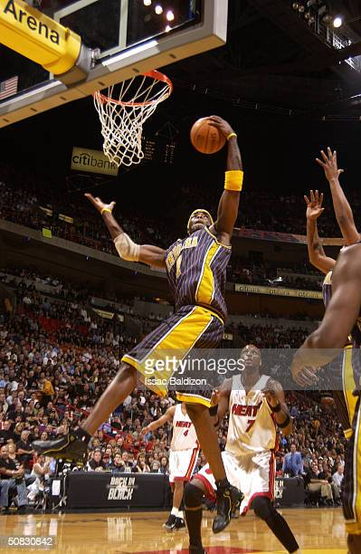 Jermaine O'Neal of the Indiana Pacers grabs a rebound over Lamar Odom of the Miami Heat in Game four of the Eastern Conference Semifinals during the...
