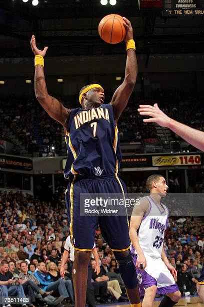 Jermaine O'Neal of the Indiana Pacers grabs the rebound with one arm against the Sacramento Kings on March 6 2007 at ARCO Arena in Sacramento...