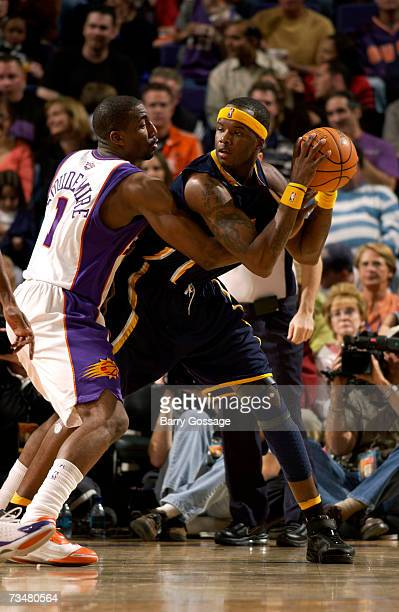 Jermaine O'Neal of the Indiana Pacers is guarded by Amare Stoudemire of the Phoenix Suns in an NBA game played on March 2 at US Airways Center in...