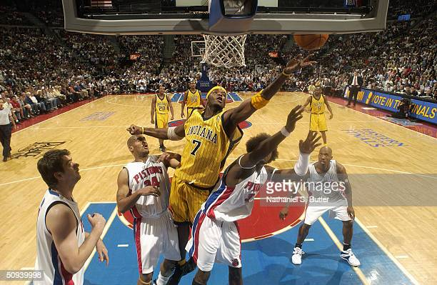 Jermaine O'Neal of the Indiana Pacers jumps for the ball between Corliss Williamson and Ben Wallace of the Detroit Pistons in game six of the Eastern...