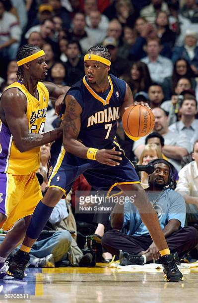Jermaine O'Neal of the Indiana Pacers moves the ball against Kwame Brown of the Los Angeles Lakers during the game on January 9 2006 at Staples...