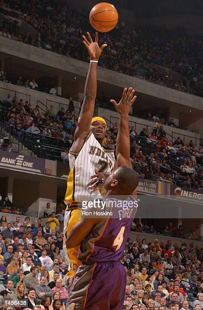 Jermaine O''Neal of the Indiana Pacers shoots a hook shot over Alton Ford of the Phoenix Suns during a game at Conseco Fieldhouse in Indianapolis...