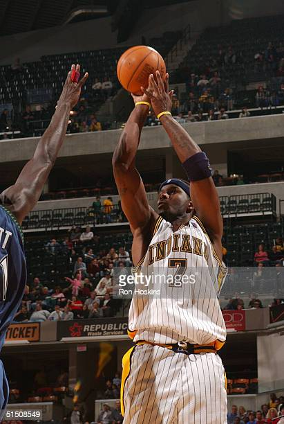 Jermaine O'Neal of the Indiana Pacers shoots over a Minnestoa Timberwolves defender during NBA preseason action on October 19, 2004 at Conseco...