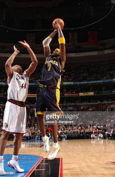Jermaine O'Neal of the Indiana Pacers shoots over Derrick Coleman of the Philadellphia 76ers at the First Union Center on March 12 2003 in...