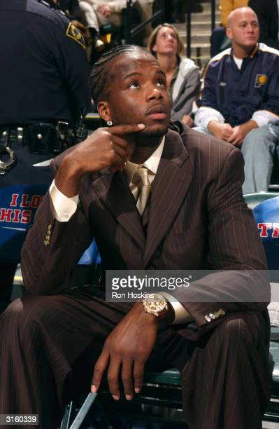 Jermaine O'Neal of the Indiana Pacers sits injured on the bench during the game at Conseco Fieldhouse on March 24, 2004 in Indianapolis, Indiana. The...