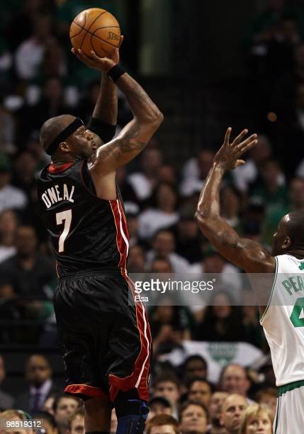 Jermaine O'Neal of the Miami Heat takes a shot as Kendrick Perkins of the Boston Celtics defends during Game One of the Eastern Conference...