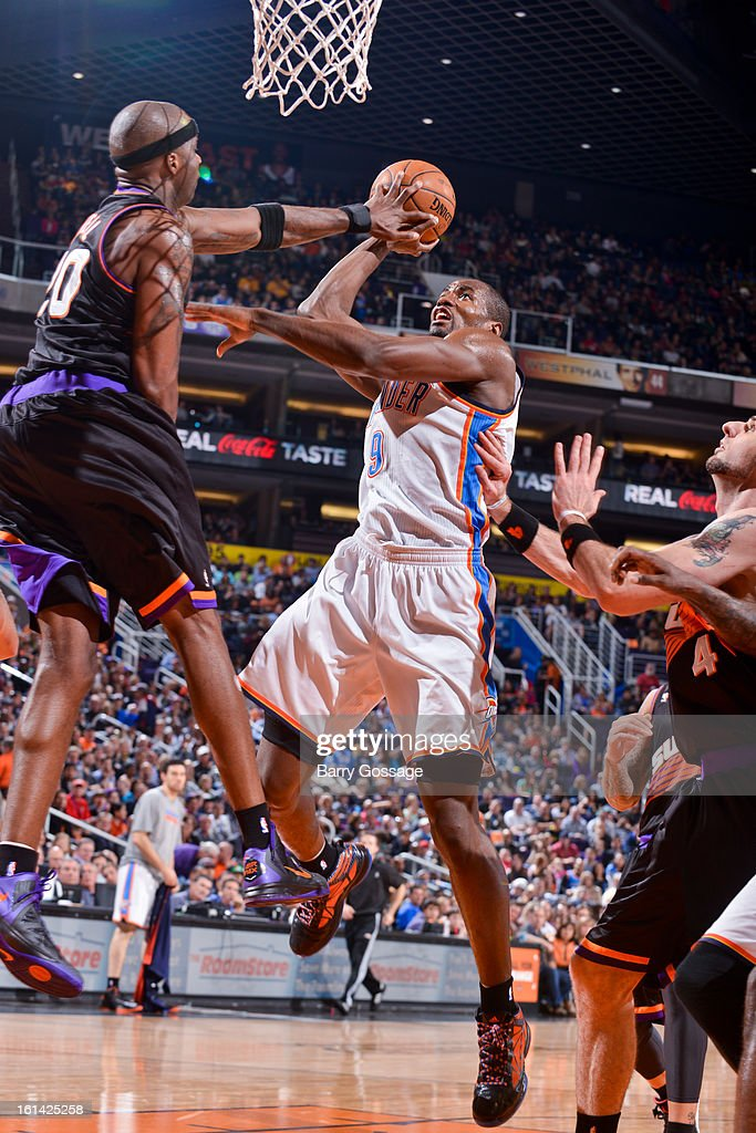 Jermaine O'Neal #20 of the Phoenix Suns contests a shot attempt by Serge Ibaka #9 of the Oklahoma City Thunder on February 10, 2013 at U.S. Airways Center in Phoenix, Arizona.