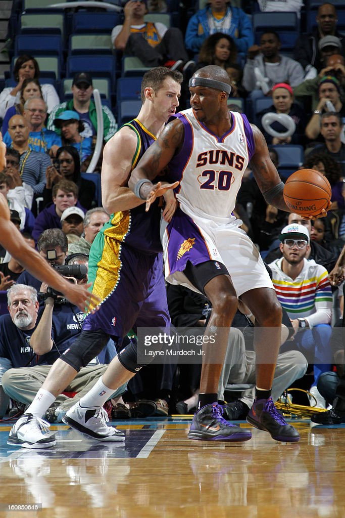 Jermaine O'Neal #20 of the Phoenix Suns controls the ball against Jason Smith #14 of the New Orleans Hornets on February 06, 2013 at the New Orleans Arena in New Orleans, Louisiana.