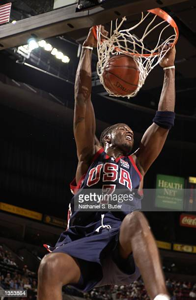 Jermaine O'Neal of the USA Basketball team dunks in the first quarter of a game against the German team at the Rose Garden on August 25 2002 in...